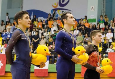 gymnasts-holding-ducks