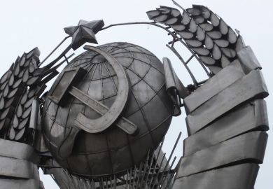 Hammer and sickle symbol on metal sculpture