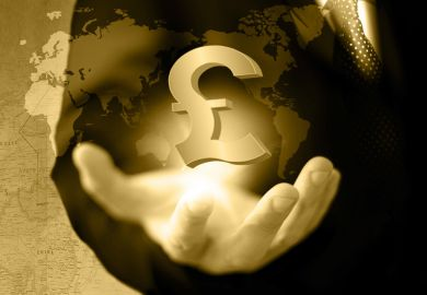 Hand holding UK pound currency symbol against world map