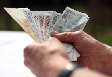 Hands full of Euros