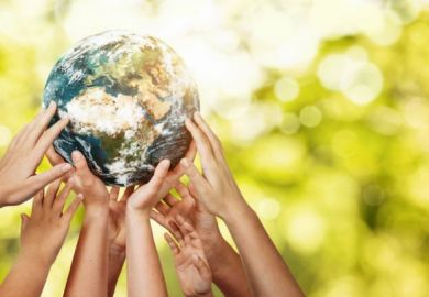 Hands holding up Planet Earth, commitment to United Nations SDGs, THE Impact Rankings 2021 blog