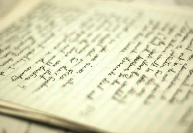 Handwritten essay on table