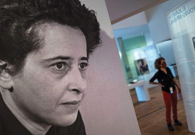 "A photograph of German-American philosopher and political theorist Hannah Arendt (L) is on display during a press preview of the exhibition ""Hannah Arendt and the Twentieth Century"" at the German Historical Museum"