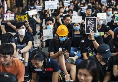 Woman in hard hat amid Hong Kong protest