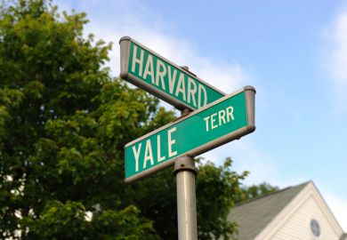 Harvard and Yale signs