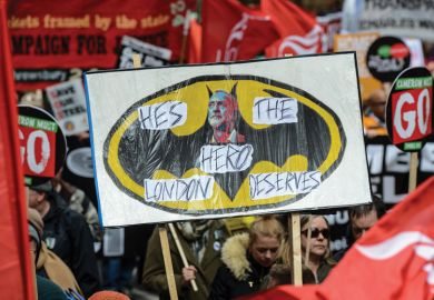 Health, Homes, Jobs and Education demonstrators hold Jeremy Corbyn placard, London