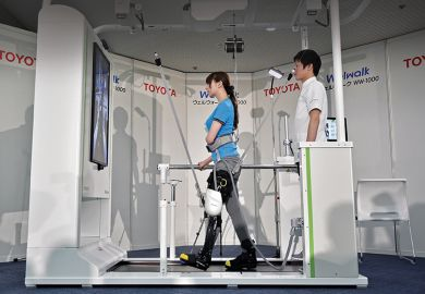 A model demonstrates how the rehabilitation-assist robot Welwalk WW-1000, developed by Japan's Toyota Motor Corporation
