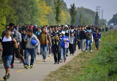 Hegyeshalom, Hungary - October 6, 2015 Group of refugees leaving Hungary. They came to Hegyeshalom by train and then they leaving Hungary and go to Austria and then to Germany. Many of them escapes from home because of civil war.