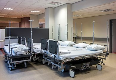 A cluster of hospital beds