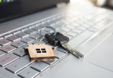 a house key on a computer