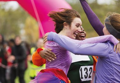 Women embrace after race