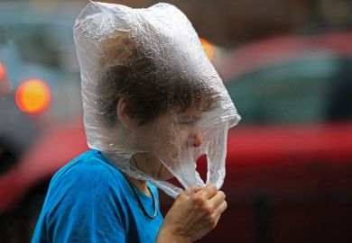 Hungarian woman wearing a plastic bag in the rain