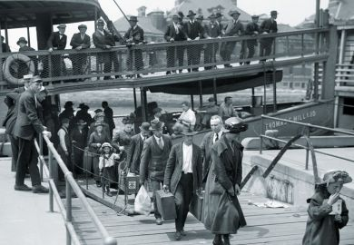 Immigrants disembarking boat, Ellis Island, New York City