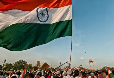 Indian flag being waved by demonstrators during protest