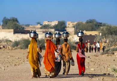 Indian women carrying water pots