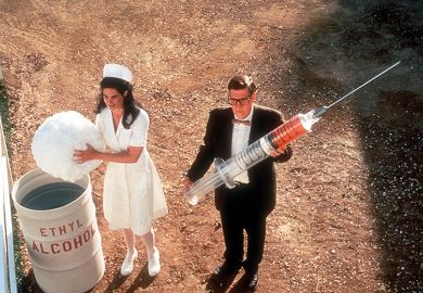 Nurse and man holding giant syringe