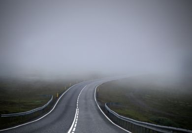 Road leading into mist