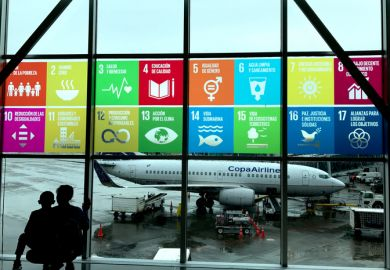 Global goals displayed in Spanish at the airport