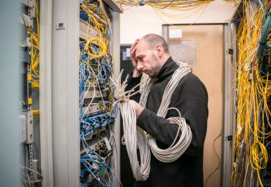 A computer technician gets lost in wires and wishes he had kept things simple.