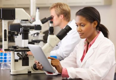 A black female scientist working in a lab