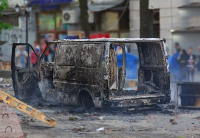 Burned car illustrating MA focusing on researching and reporting far-right extremism