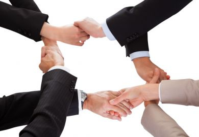 Intertwined handshakes symbolising overlap in interests and academic collaboration