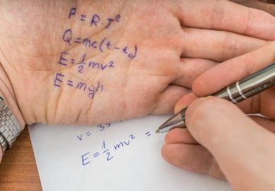 Test answers written on the palm of a hand