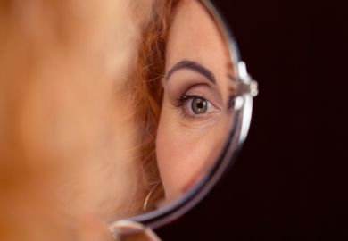 A woman's eye reflected in a mirror