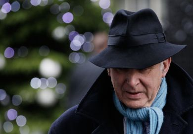 Vince Cable in a fedora hat