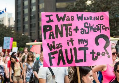 "A protest sign reading ""I was wearing pants + a sweater, was it my fault too?"" Taken during ""Slut Walk 2012"" in Toronto."