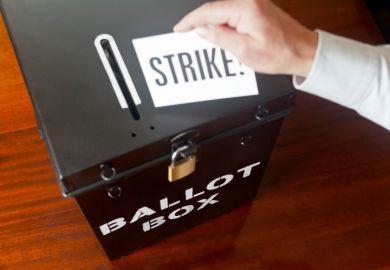 man placing strike ballot card into box