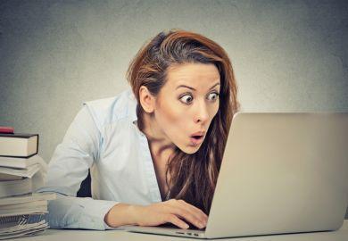 Shocked woman at computer