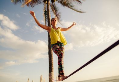 Teenage girl balancing on slack line