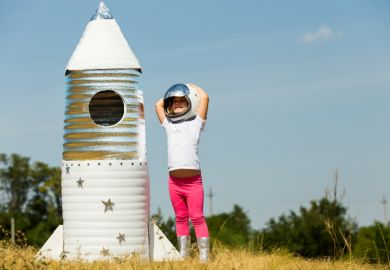 Happy child dressed in an astronaut costume