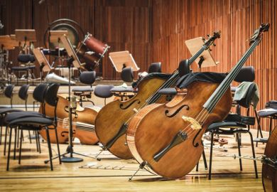 Cellos in an empty auditorium