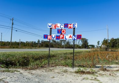 "A sign reading ""Welcome to Trumpland"""