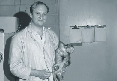 John Gluck holding monkey research subject, 1968