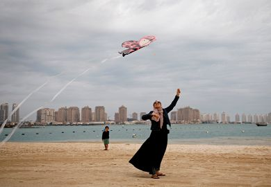Flying kite on beach