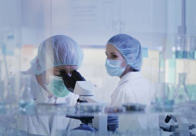 Two people in lab
