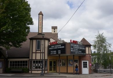 Lake Oswego, OR, USA - July 4, 2020: The cinema billboard at Lake Theater in downtown Lake Oswego shows the numbers of newly reported COVID-19 cases in Oregon.