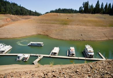 Lake Shasta, USA - August 17, 2014 California's lingering drought exposes the 180-200 foot drop in water levels. The state's largest reservoir is receding at an average of 4.9 inches per day. The 3-year-long drought is affecting tourism and boating recrea