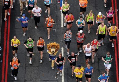 Runner in lion fancy-dress