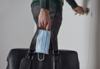 A man leaves home with a suitcase and a surgical mask