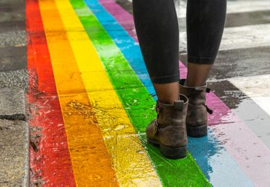 Legs walking on rainbow crossing, LGBT+ inclusion