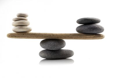 Stones balanced on a see-saw, symbolising the UK government's levelling up agenda