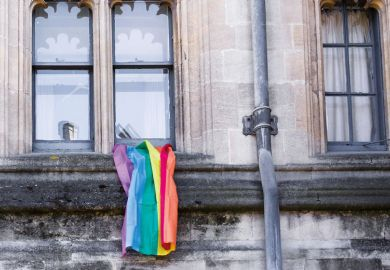 LGBT rainbow flag hanging outside university building