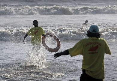 Life guards demonstrate the skill of saving lives at Juhu Beach, Mumbai