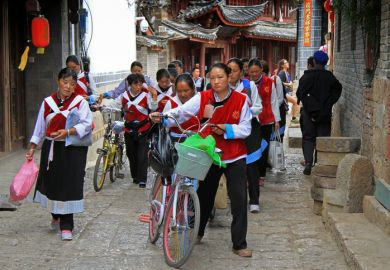 Women in the same clothes on the street in Lijiang, China, June 2015, illustrating repetition in postgraduate education in China