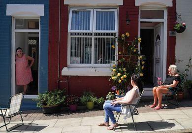 Women outside a house