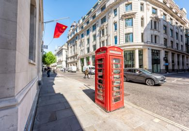 London, UK - June 26, 2018 Bank of china in business center architecture wide angle view with red telephone booth